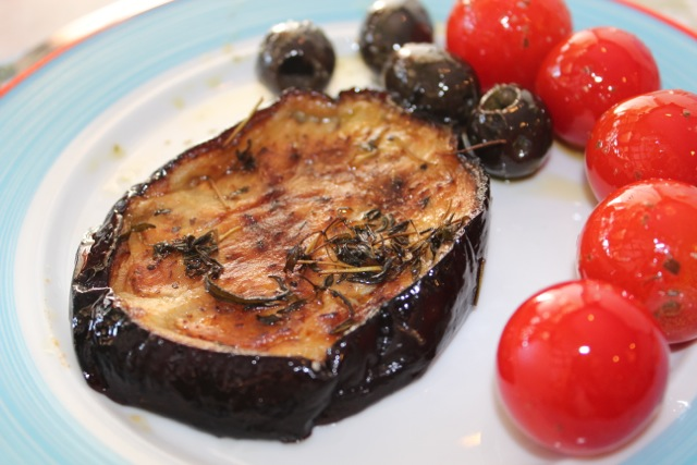 Eggplant with rosemary, cherry tomatoes and olives for breakfast.