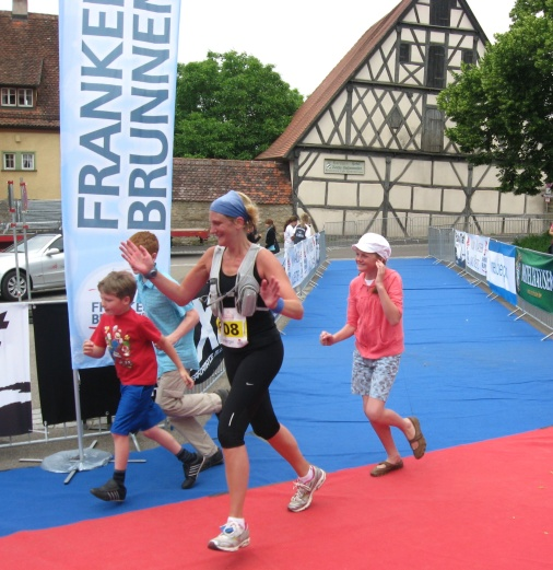 The kids and I crossing the finish line together at my first race ever.