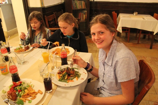 Katie having salmon, and in the background, spaghetti and more schnitzel (you can take the kids out of Germany…)
